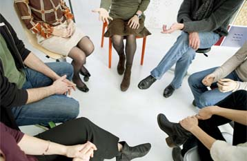 An image showing people during a group therapy session in rehab